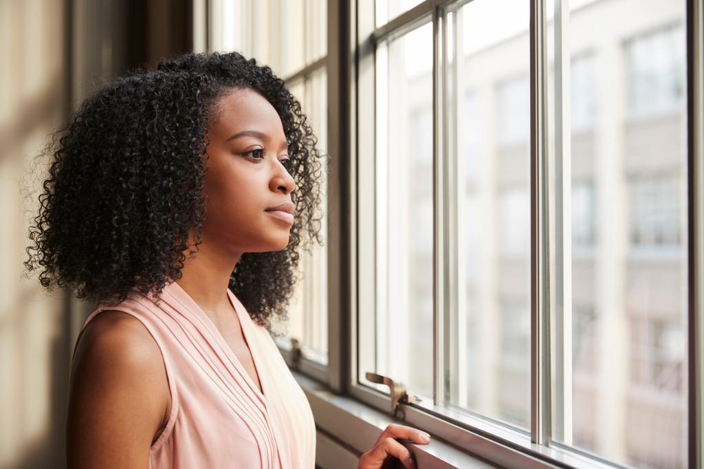 young black businesswoman looking out of window picture id904595340 image
