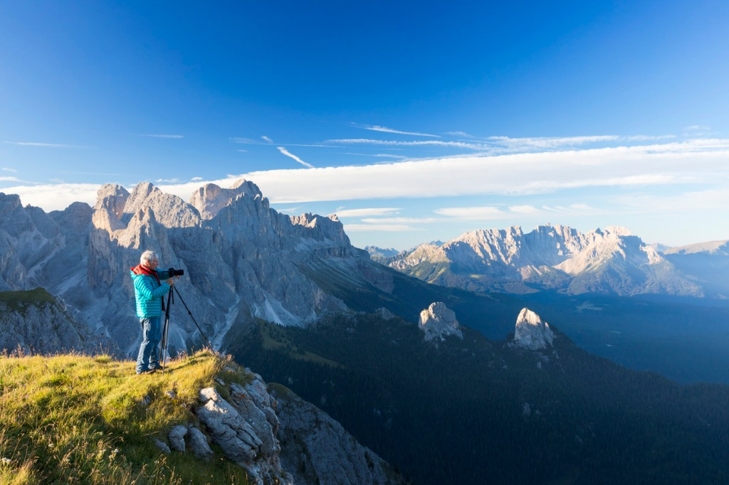 nature photographer in the alps at catinaccio latemar mountain group picture id946758390 image