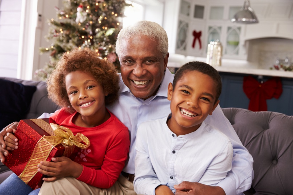 grandfather with grandchildren opening christmas gifts picture id498795340 image