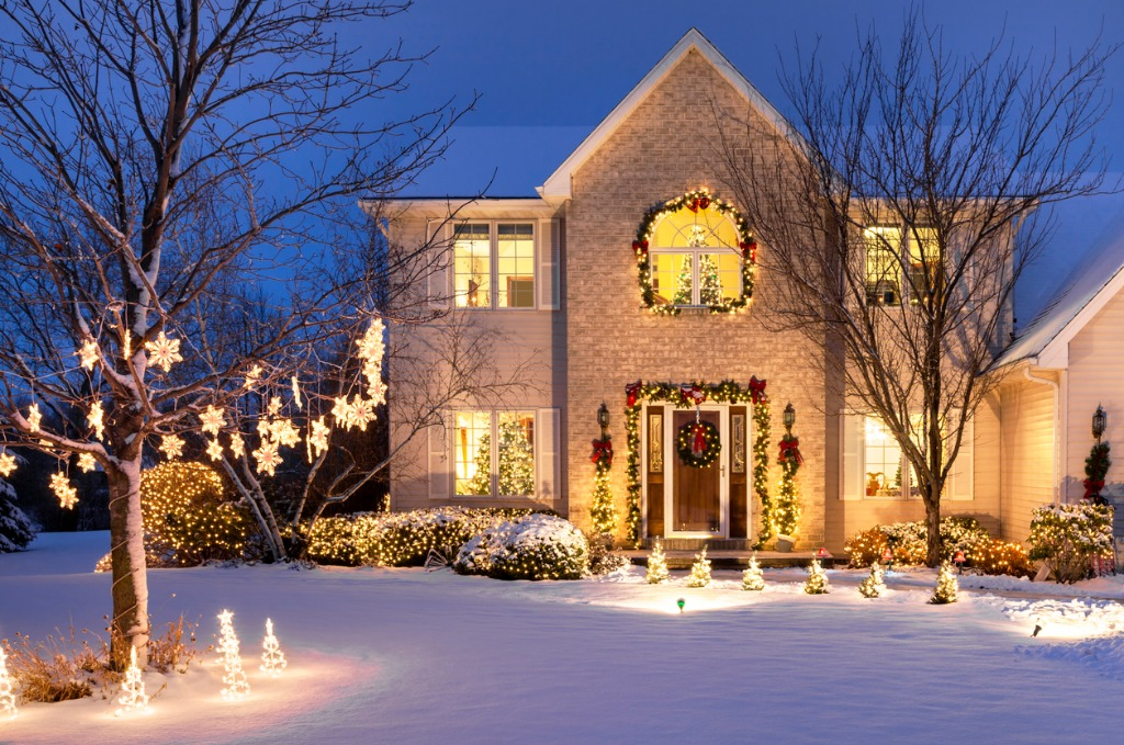 home with festive christmas lighting and snow picture id526310157 image