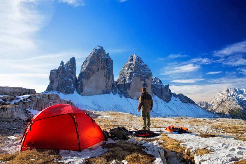 lonely photographer with tent at the three pinnacles in wintertime picture id496068164 image