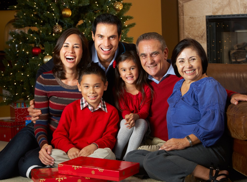 multi generation family in front of christmas tree picture id158499321 image