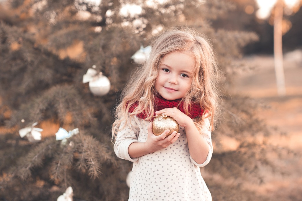 smiling kid girl with christmas decorations picture id599910212 image