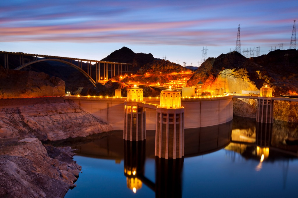 hoover dam lit up for the night during sunset picture id178515285 image