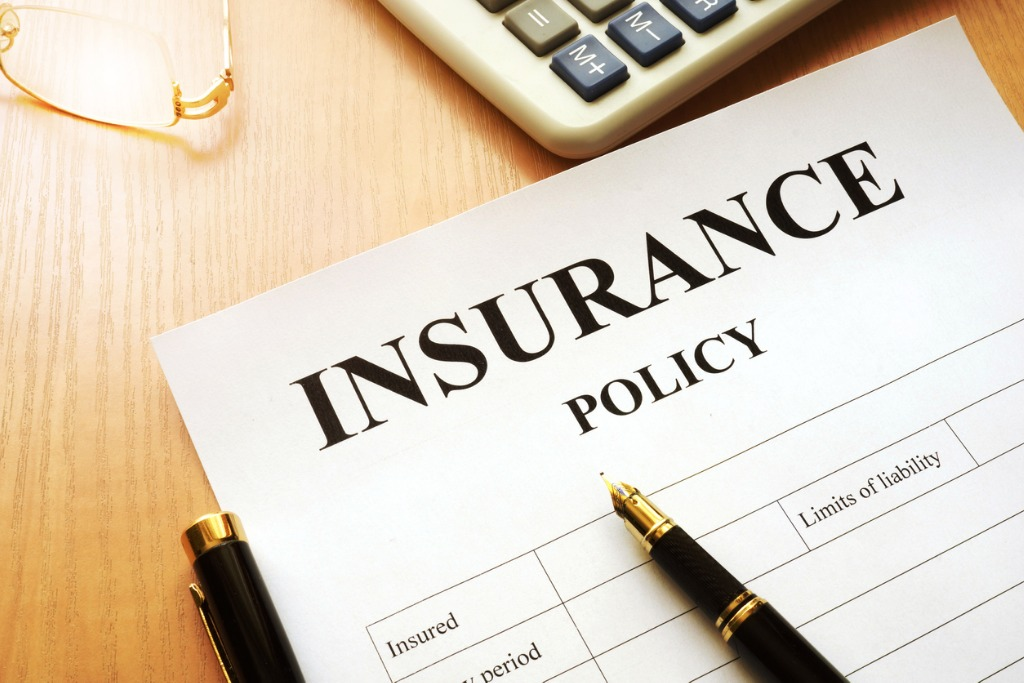 insurance policy on a desk picture id841218106 image
