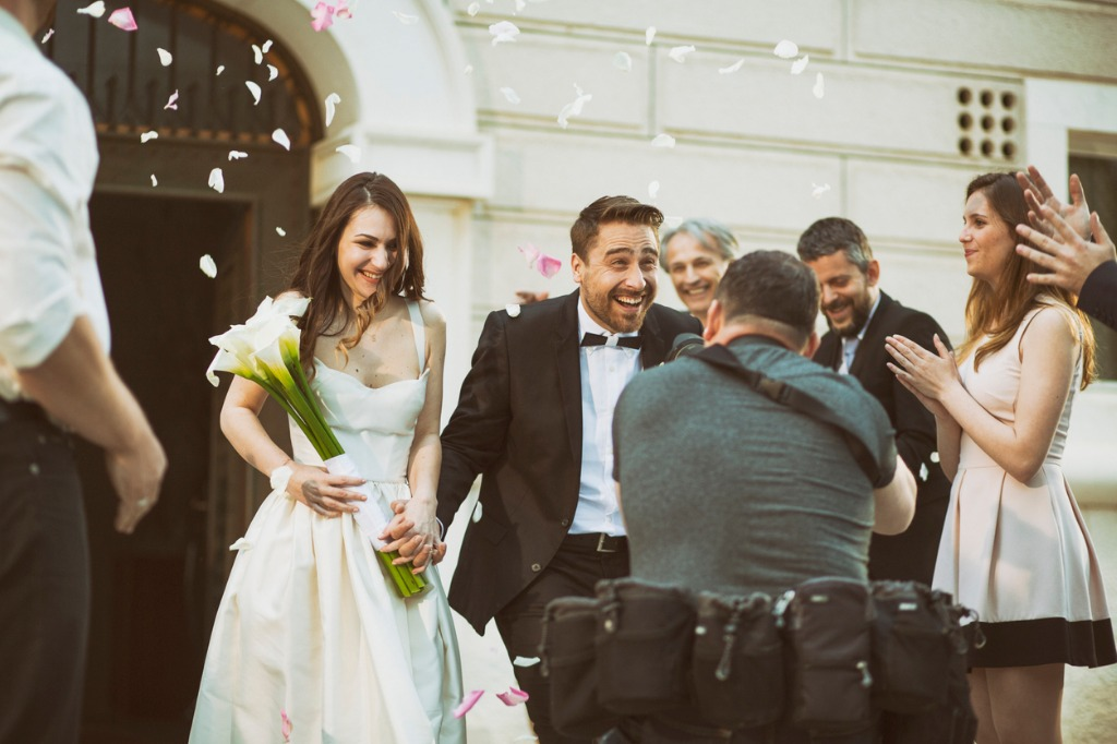 photographer taking picture of newlywed couple picture id588266922