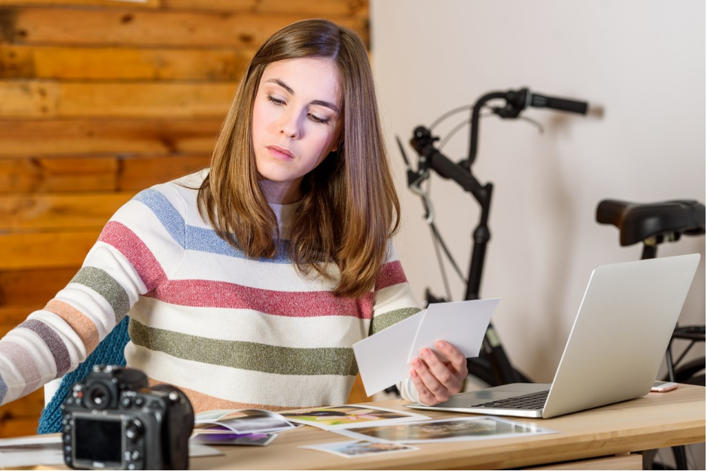 photographer woman choosing photos on desktop image