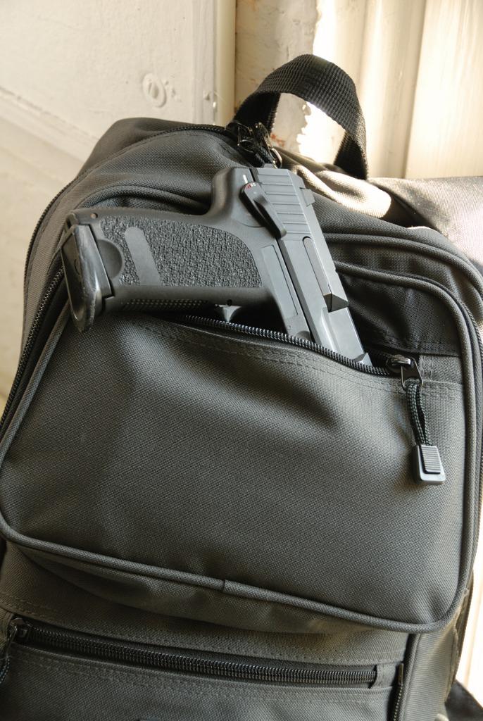 gun in bookbag picture id172324458 image