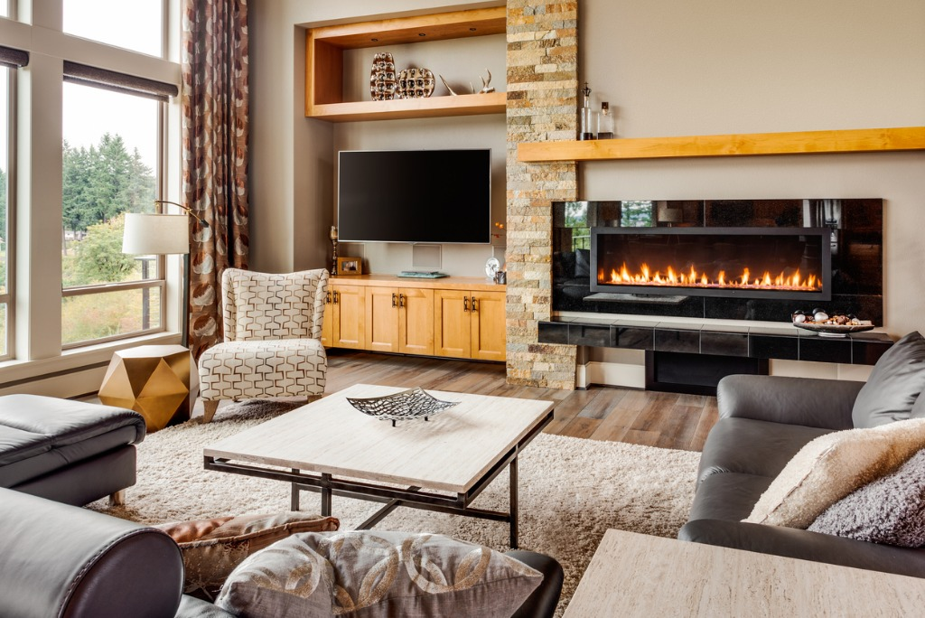 living room in luxury home with fireplace and tv picture id471104644
