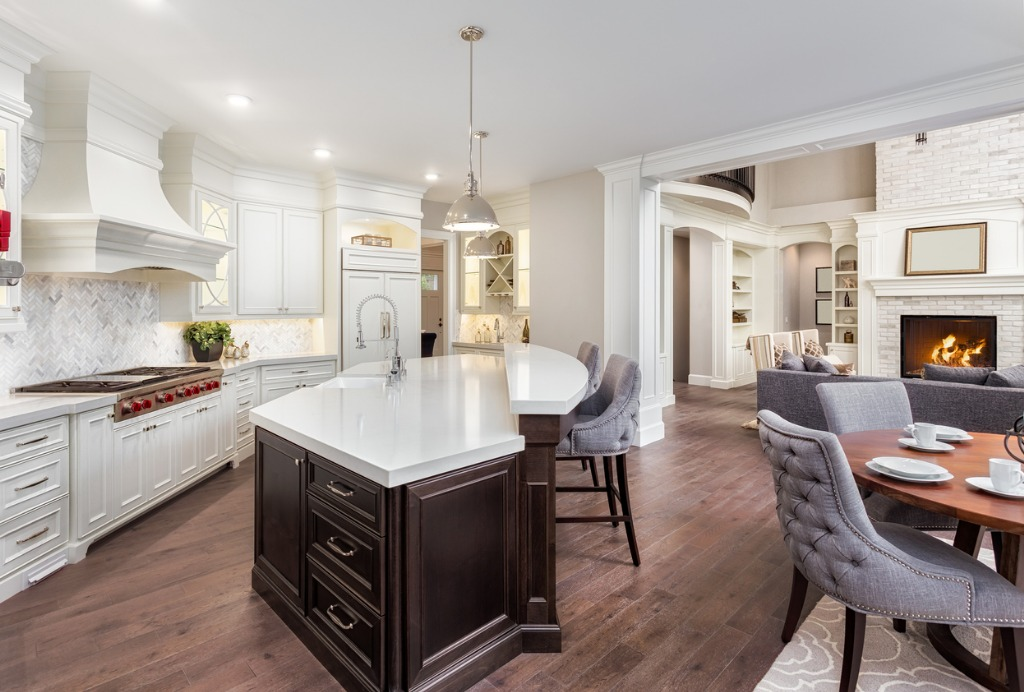beautiful kitchen in new luxury home with island pendant lights and picture id692601434