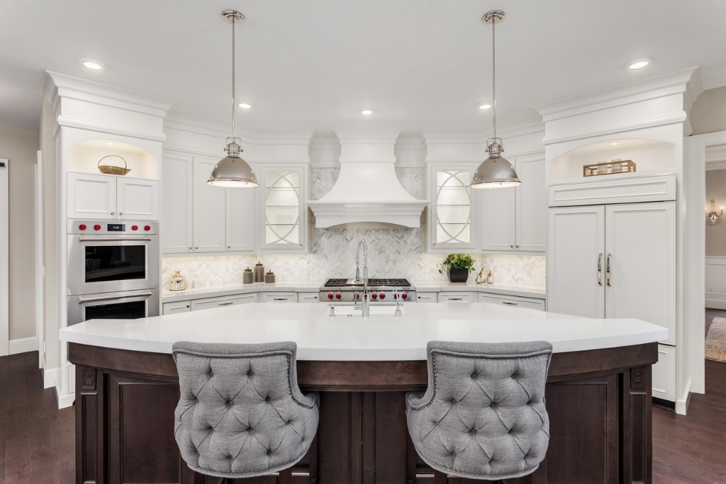 beautiful kitchen in new luxury home with island pendant lights and picture id950127388
