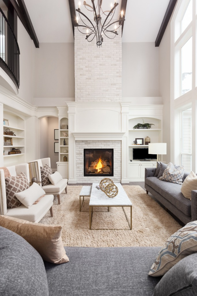 beautiful living room interior with tall vaulted ceiling loft area picture id856794602