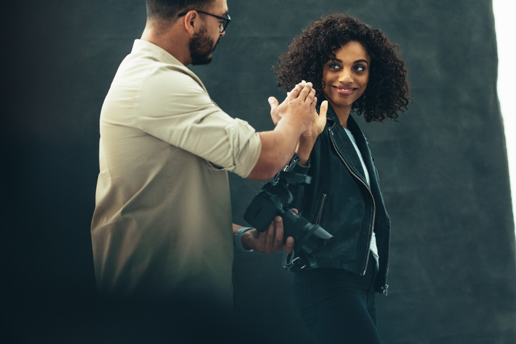 photographer giving a high five to a female model during a photo picture id1053106286