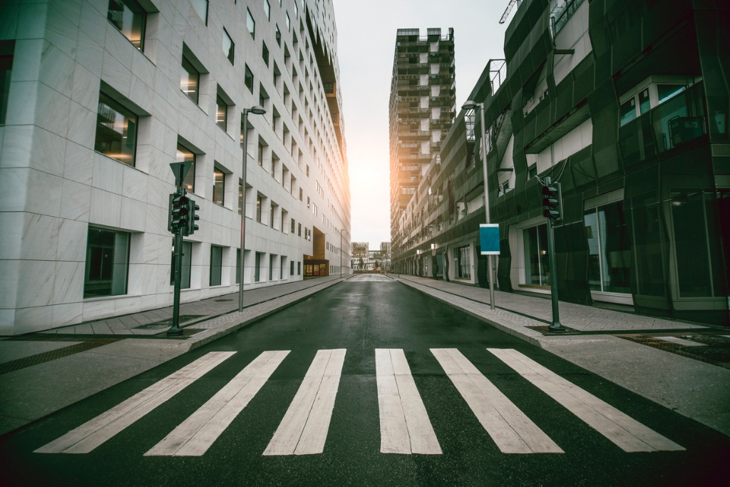 empty urban street with skyscraper at sunrise picture id937620870 image