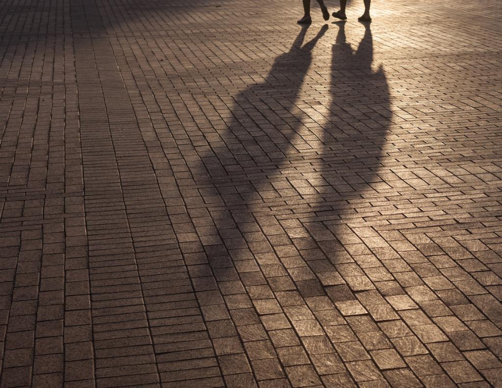 shadow of walking people on sidewalk picture id906718028 image