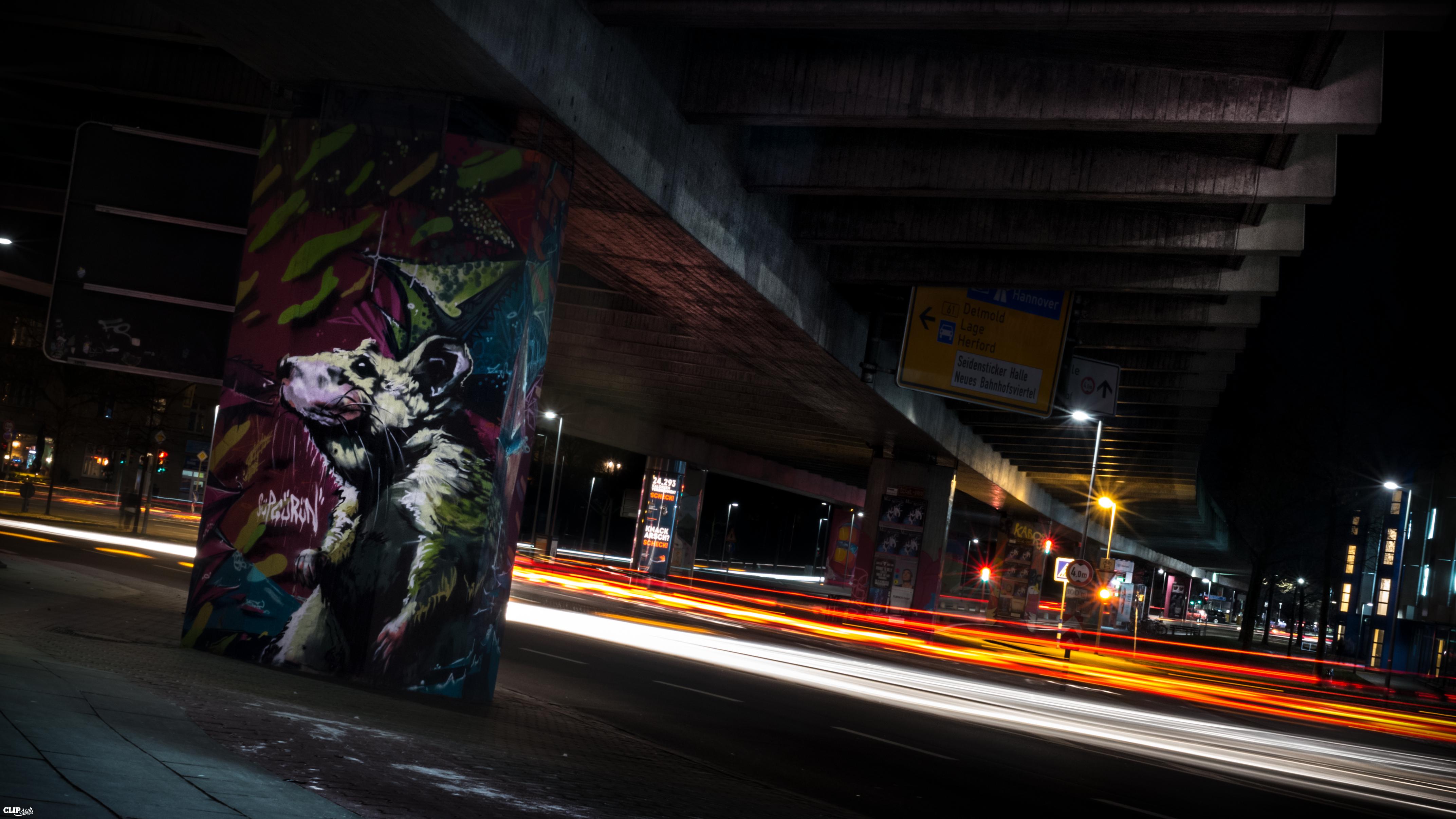 Car Trails below a bridge with graffity 1
